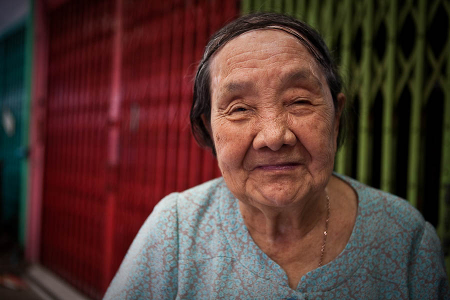 """""""Go on then, take a picture!"""" Old lady smiling in Bangkok Chinatown"""