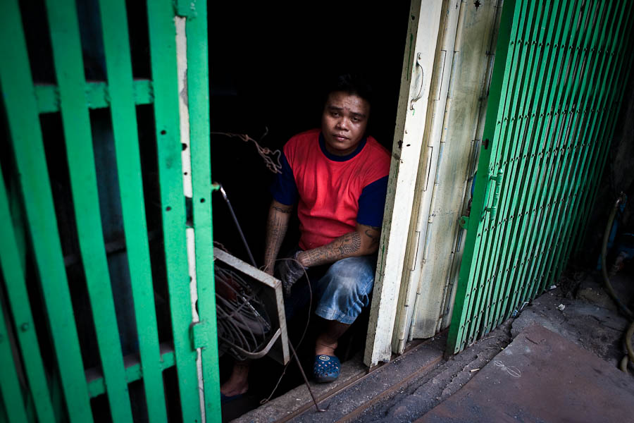 Pink man between green shutters, Chinatown, Bangkok